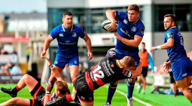 Jordan Larmour of Leinster is tackled by Jack Dixon of Dragons during the Guinness PRO14 Round 1 match between Dragons and Leinster at Rodney Parade in Newport, Wales. Photo by Ramsey Cardy/Sportsfile