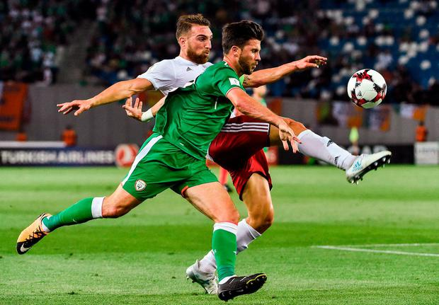 Shane Long of Republic of Ireland in action against Guram Kashia of Georgia during the FIFA World Cup Qualifier Group D match between Georgia and Republic of Ireland at Boris Paichadze Dinamo Arena in Tbilisi, Georgia. Photo by David Maher/Sportsfile