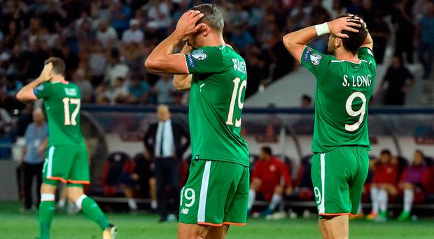 Shane Long, right of Republic of Ireland reacts after his header goes wide during the FIFA World Cup Qualifier Group D match between Georgia and Republic of Ireland at Boris Paichadze Dinamo Arena in Tbilisi, Georgia. Photo by David Maher/Sportsfile