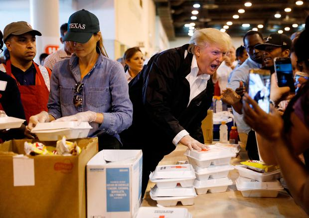U.S. President Donald Trump and first lady Melania Trump help volunteers hand out meals during a visit with flood survivors of Hurricane Harvey at a relief center in Houston, Texas, U.S., September 2, 2017. REUTERS/Kevin Lamarque