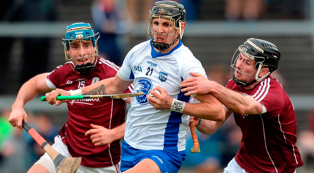 Maurice Shanahan of Waterford in action against Conor Cooney, left, and Pádraic Mannion of Galway. Photo: Piaras Ó Mídheach/Sportsfile