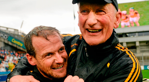 Jackie Tyrrell and Brian Cody celebrate beating Limerick in the 2014 All-Ireland semi-final. Photo: Paul Mohan/Sportsfile