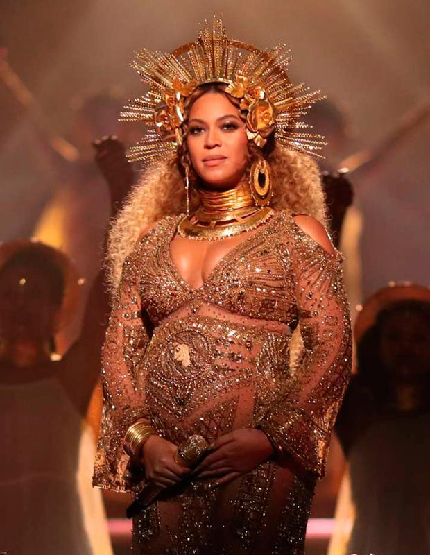 GROWING UP IN PUBLIC: An eight-month pregnant Beyonce performing at last year's Grammy awards ceremony