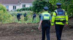 SEARCH: Gardai at the site near Chapelizod in West Dublin where they have spent three weeks searching for missing bank official Trevor Deely