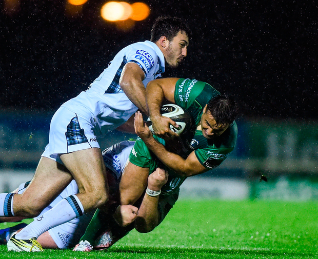 Cian Kelleher of Connacht Rugby is tackled by Leonardo Sarto and Zander Fagerson of Glasgow Warriors Photo: Sportsfile