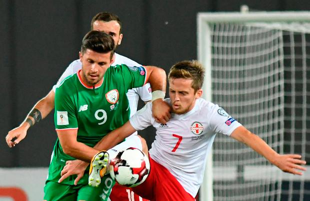 Ireland's Shane Long (L) vies Georgia's Jano Ananidze (R) Photo: Getty