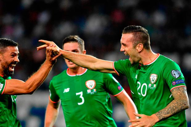 Ireland's Shane Duffy (R) and his teammates celebrate their goal