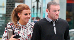 EXPLAINING TO DO: Wayne Rooney with his wife Coleen who is expecting their fourth child
