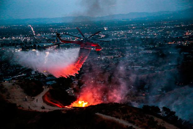 Water is dropped above homes in Sun Valley during the La Tuna Canyon fire over Burbank, California, U.S., September 2, 2017. REUTERS/ Kyle Grillot