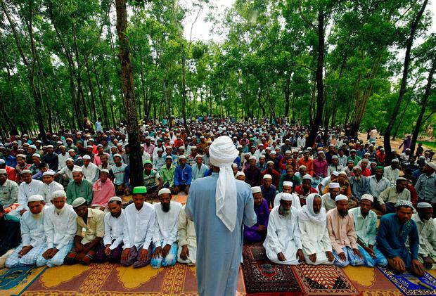 Rohingya refugee people take part in Eid al-Adha prayer near the Kutupalang makeshift refugee camp, in Cox's Bazar, Bangladesh, September 2, 2017. REUTERS/Mohammad Ponir Hossain
