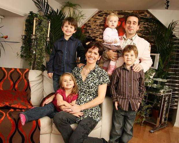 Peter Kelly and Eadaoin Morrish pictured with their children Cameryn , Codi Ross , Jessie Mai and Mia Darina at their home in Fermoy in 2006