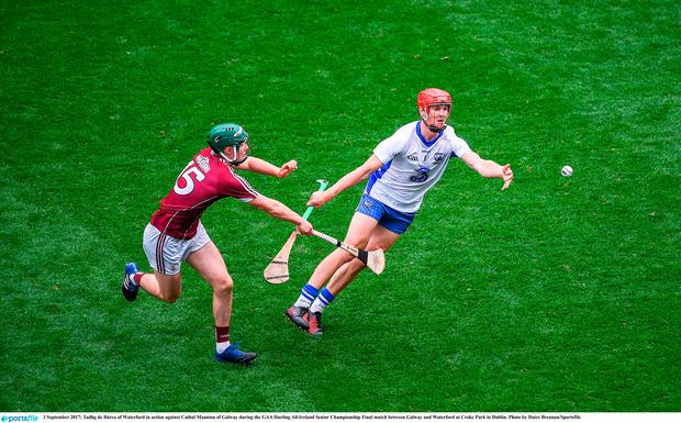 Tadhg de Búrca of Waterford in action against Cathal Mannion of Galway