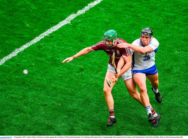 Adrian Touhy of Galway in action against Kevin Moran of Waterford