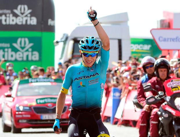 Miguel Angel Lopez Moreno celebrates as he crosses the line winning the 15th stage of the Tour of Spain from Alcala La Real to Sierra Nevada. Photo: Getty Images