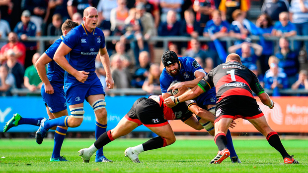 Scott Fardy of Leinster is tackled by Brok Harris of Dragons. Photo by Ramsey Cardy/Sportsfile