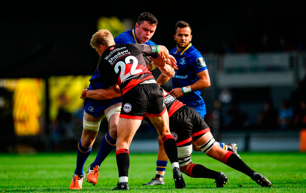 James Ryan of Leinster is tackled by Angus O'Brien, left, and James Benjamin of Dragons. Photo by Ramsey Cardy/Sportsfile