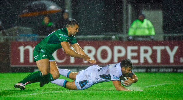 Ali Price of Glasgow Warriors scores a try against Connacht Rugby despite the tackle of Cian Kelleher. Photo by Matt Browne/Sportsfile