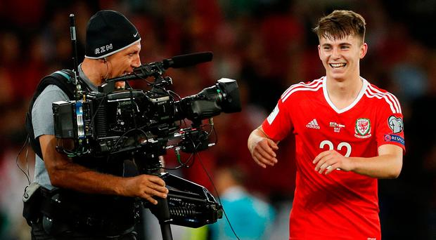 Wales' hero Ben Woodburn celebrates after their victory over Austria. Photo: Reuters/John Sibley