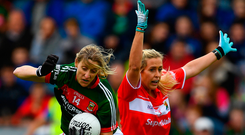 Mayo sharpshooter Cora Staunton is challenged by Cork's Bríd Stack during the Connacht side's victory in the TG4 Ladies All-Ireland SFC semi-final on Saturday. Photo: Sportsfile
