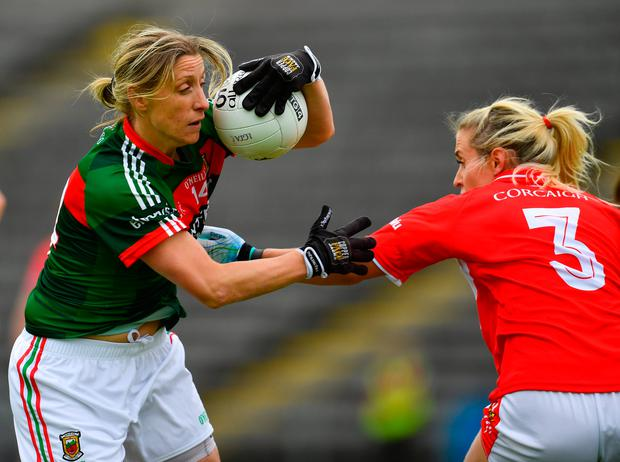 Mayo's Cora Staunton tries to find a way past Cork's Bríd Stack. Photo: Sportsfile