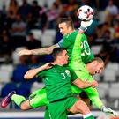 Ireland's Shane Duffy scores a header past Georgia's goalkeeper Giorgi Makaridze who was under pressure from Ciaran Clark. Photo: Getty Images