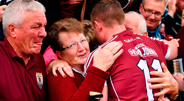 Joe Canning of Galway celebrates with his mother Josephine, father Sean, hidden and a family friend (left) following the the GAA Hurling All-Ireland Senior Championship Final match between Galway and Waterford at Croke Park in Dublin. Photo by Sam Barnes/Sportsfile