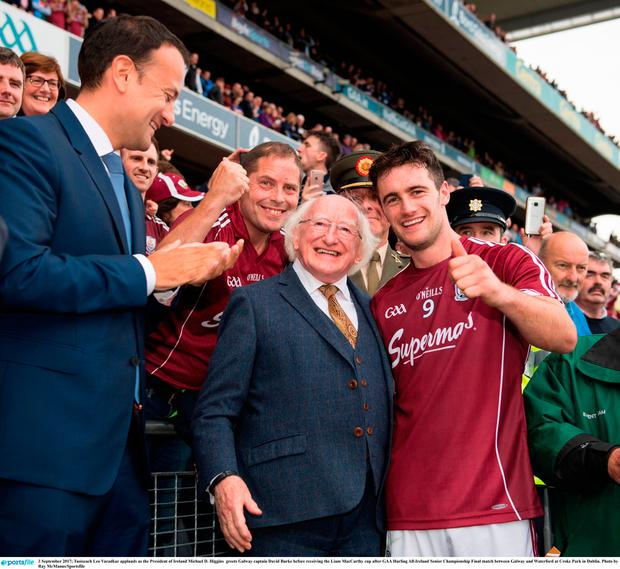 3 September 2017; Taoiseach Leo Varadkar applauds as the President of Ireland Michael D. Higgins greets Galway captain David Burke before receiving the Liam MacCarthy cup after GAA Hurling All-Ireland Senior Championship Final match between Galway and Waterford at Croke Park in Dublin. Photo by Ray McManus/Sportsfile