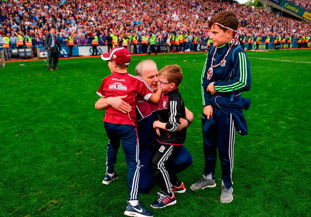 Galway manager Micheál Donoghue celebrates with his sons, from left, Niall, Con, and Cian, following this side's victory