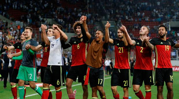 Belgium players celebrate after qualifying for the 2018 World Cup REUTERS/Costas Baltas
