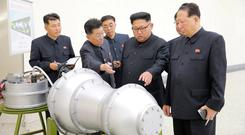 In this propaganda photo, Kim Jong-un examines what the North Koreans want us to believe is the nuclear warhead that was later tested. Photo: Reuters