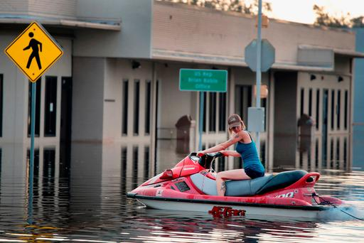 A volunteer heads out on a jet ski to look for people in need of help in Orange, Texas, yesterday. Photo by Scott Olson/Getty Images