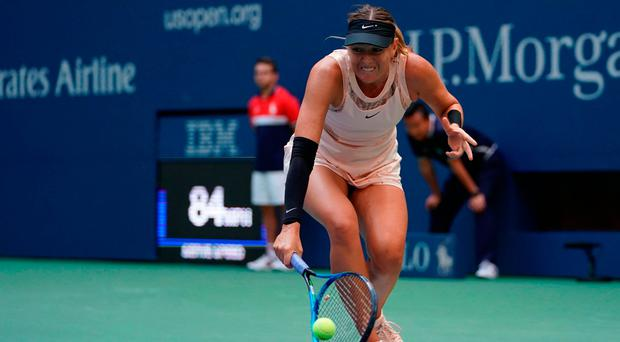 Maria Sharapova grimaces as she stretches to make a return during her defeat by Anastasija Sevastova in the US Open. Photo: Getty Images