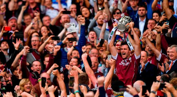 Galway captain David Burke lifts the Liam MacCarthy cup after the GAA Hurling All-Ireland Senior Championship Final match between Galway and Waterford at Croke Park in Dublin. Photo by Eóin Noonan/Sportsfile
