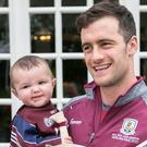 Galway Captain David Burke with Eight Month old Dara Kearns from Moycullen at the City West Hotel this morning