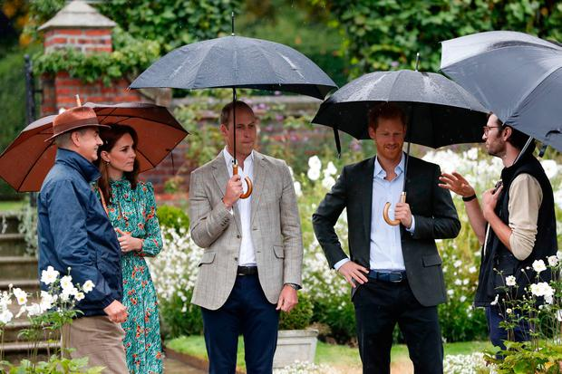 The Duke and Duchess of Cambridge and Prince Harry visit the White Garden in Kensington Palace, London, as they meet with representatives from charities supported by Diana, the Princess of Wales. Kirsty Wigglesworth/PA Wire