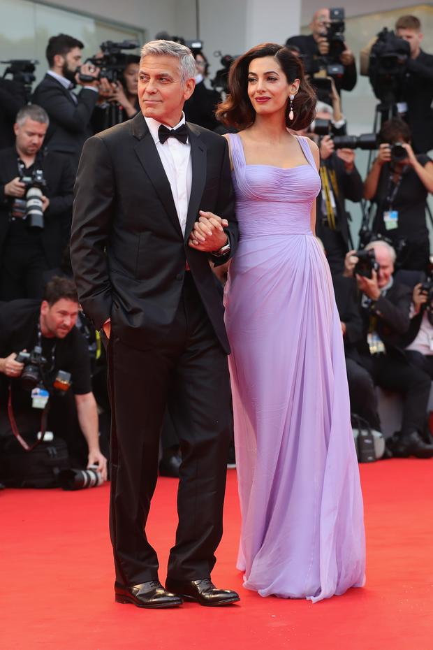 George Clooney and Amal Clooney walk the red carpet ahead of the 'Suburbicon' screening during the 74th Venice Film Festival at Sala Grande on September 2, 2017 in Venice, Italy. (Photo by Vittorio Zunino Celotto/Getty Images)