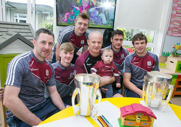 Galway hurlers Colm Callanan, Darren Morrissey (Minor) Joe Canning, Manager Micheal Donoghue, David Burke and Joe Cooney with 10 month old Conor Murray from Galway at Crumlin Childrens Hospital. Photo: Kyran O'Brien