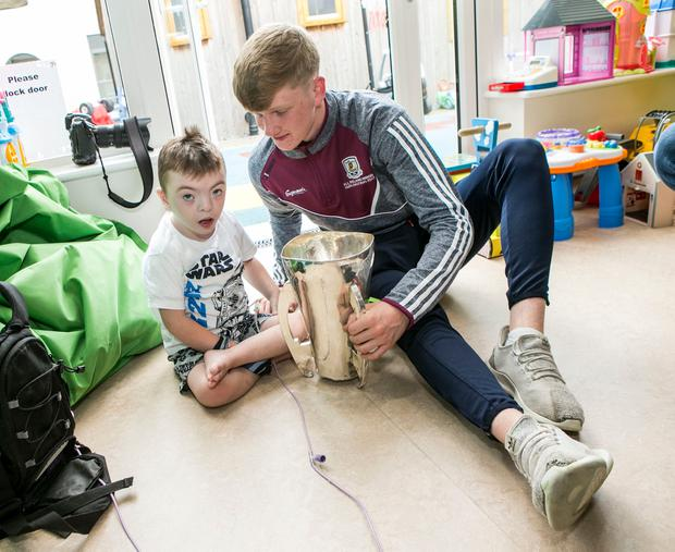 Galway Minor Darren Morrissey with Cian Byrne (4) from Finglas at Crumlin Childrens Hospital. Photo: Kyran O'Brien