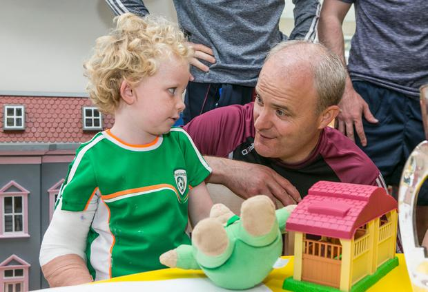 Galway hurling manager Micheál Donoghue with James Dillon (4) from Galway at Crumlin Childrens Hospital. Photo: Kyran O'Brien