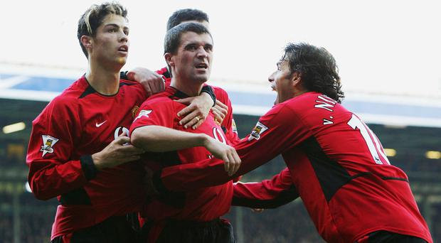 Roy Keane of Man Utd celebrates with Ruud Van Nistelrooy and Cristiano Ronaldo