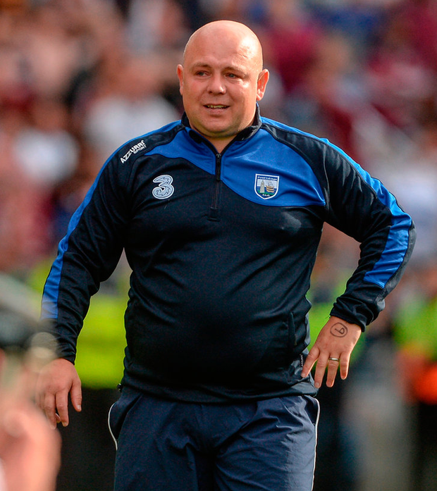 Waterford manager Derek McGrath can't hide the pain of defeat on Sunday with Kevin Moran in the foreground. Photo: Sportsfile