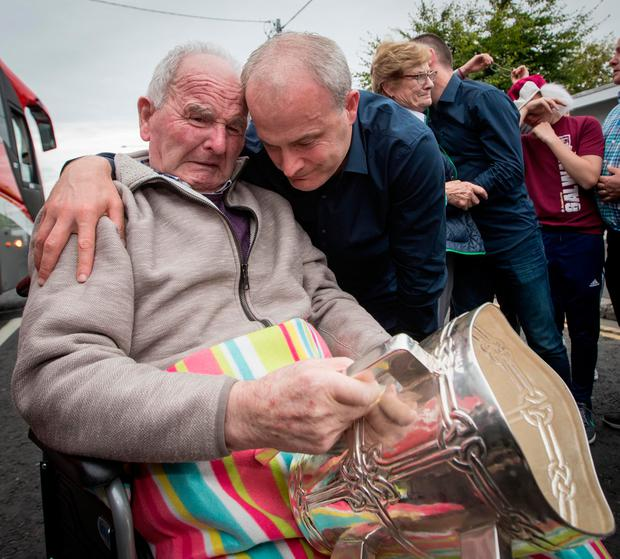 Galway manager Micheal Donoghue shows the Liam MacCarthy to his father Miko Donoghue for the first time in Ballinasloe Mandatory Credit ©INPHO/Morgan Treacy