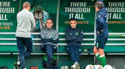 Ireland manager sits alongside injured captain Seamus Coleman at training yesterday while chatting with Roy Keane and coach Steve Guppy. Photo: Sportsfile