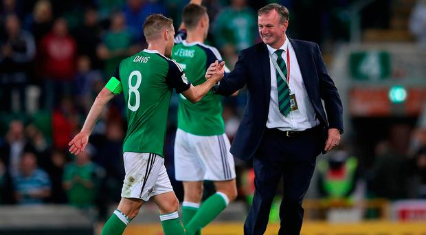 Northern Ireland manager Michael O'Neill celebrates with Steven Davis