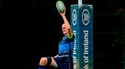 Devin Toner doing his stretching routine at Leinster training. Photo: Ramsey Cardy/Sportsfile