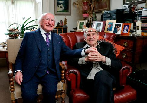 President Michael D Higgins conferred the Golden Torc on Tom Murphy at his home in Dublin. Photo: Maxwells