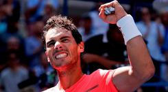Rafael Nadal celebrates after beating Alexandr Dolgopolov during the fourth round of the U.S. Open. Photo: AP