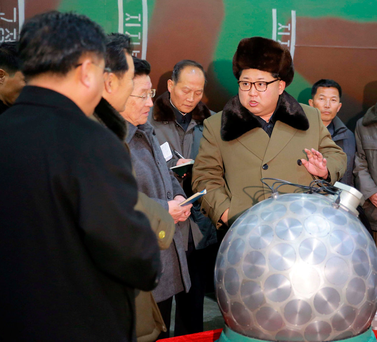 North Korean leader Kim Jong-un meets scientists and technicians in the field of researches into nuclear weapons in this photo released by North Korea's Korean Central News Agency in Pyongyang last year. Photo: Reuters
