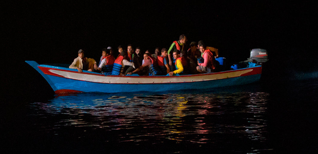 A wooden boat carrying migrants approaches the Aquarius rescue vessel of SOS Méditerranée and MSF (Doctors Without Borders) NGOs, in the Mediterranean Sea, some 74km north of the Libyan coast last week. Photo: AP