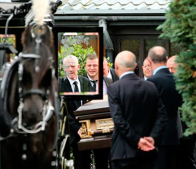 The remains of Danielle Carroll are taken from the church after her funeral Mass Photo: Gerry Mooney